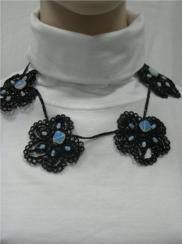 Embroided black flower necklace.