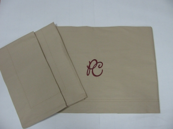 BEIGE SHEET WITH INITIAL